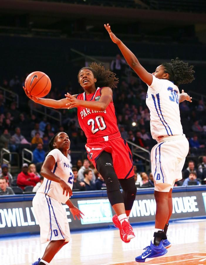 Apr 4, 2015; New York, NY, USA; Miami Country Day forward Kelsey Marshall (20) goes up for a shot while being defended by Dillard High School forward Ragene Grier (30) during the second half during the Dick's Sporting Goods High School Nationals girls final at Madison Square Garden. Miami defeated Dillard 57-41.  Mandatory Credit: Andy Marlin-USA TODAY Sports ORG XMIT: USATSI-224066 ORIG FILE ID:  2015044_jcd_bm4_028.JPG