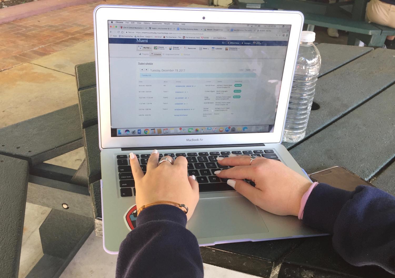 Student checks her schedule