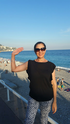 Madame Schultz in front of the Mediterranean Sea in Nice in 2016 during a GATEway summer.