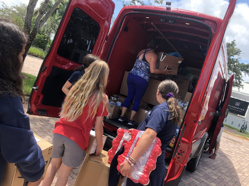 Students packing the first relief van to go the Bahamas.