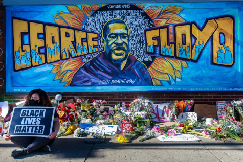 "This is just one of the many memorials set up for  ""Justice for George."" This mural is in Minneapolis."